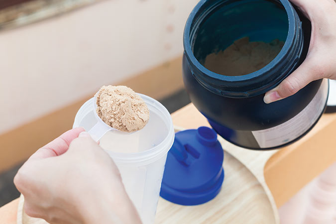 Scooping protein powder from container