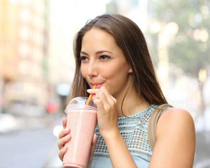Woman drinking protein smoothie