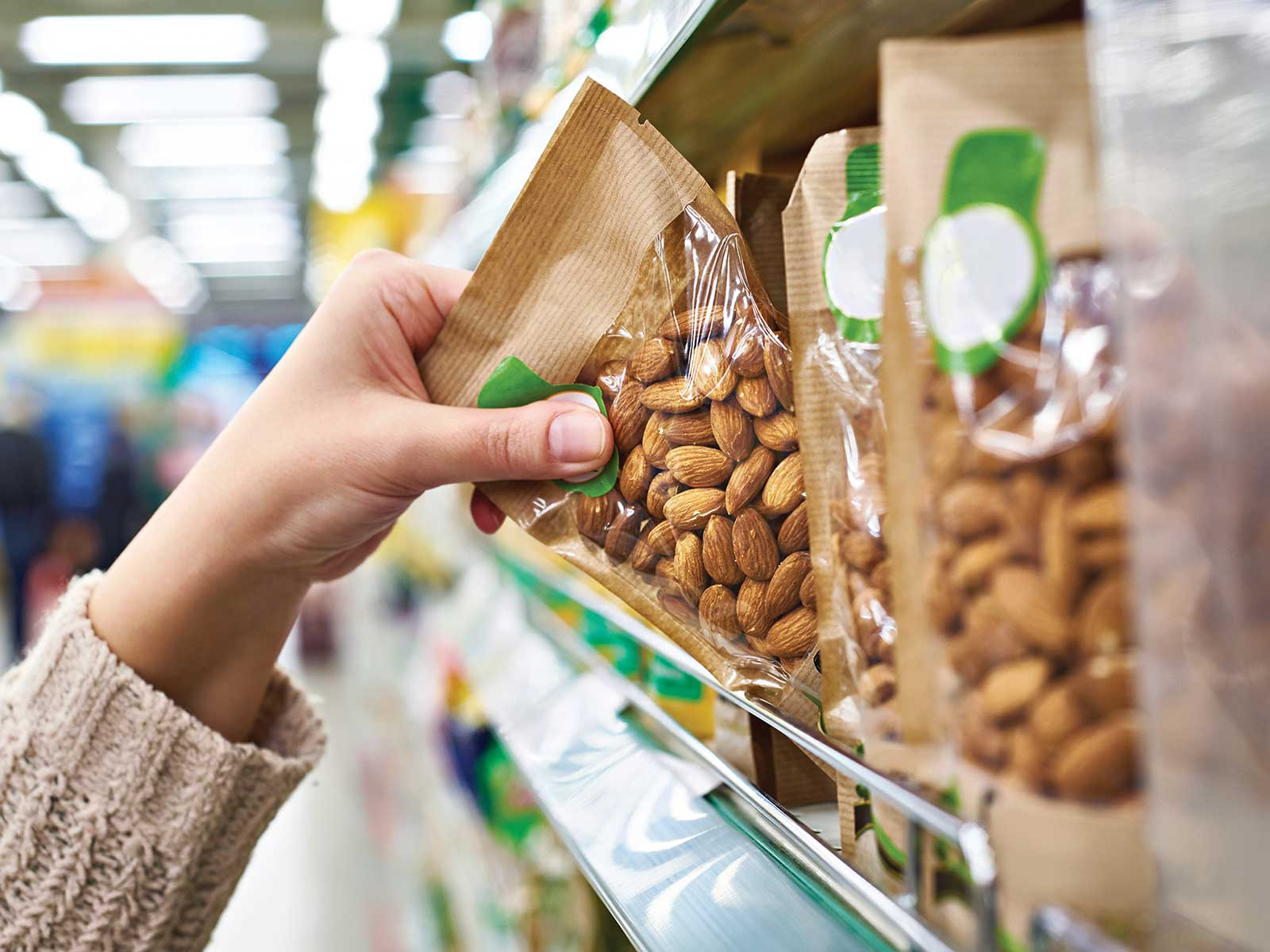 Shopper grabbing almond package